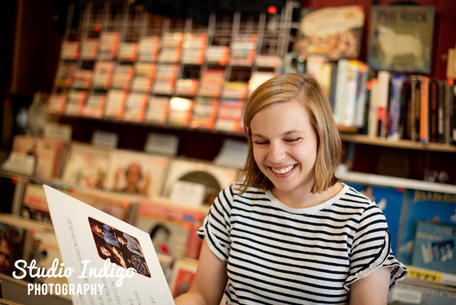 Senior portrait of girl looking through records
