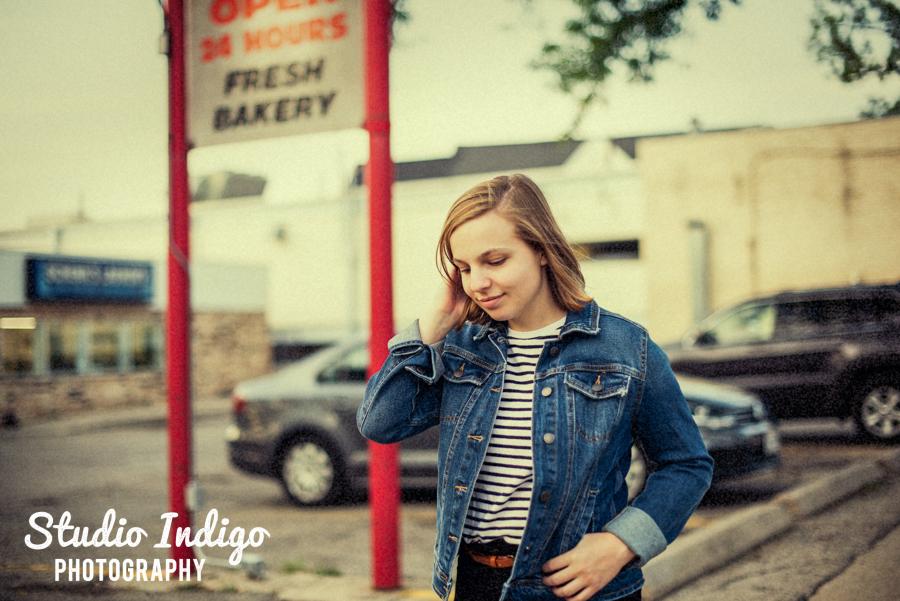 Portrait of high school senior girl walking in street with vintage filter