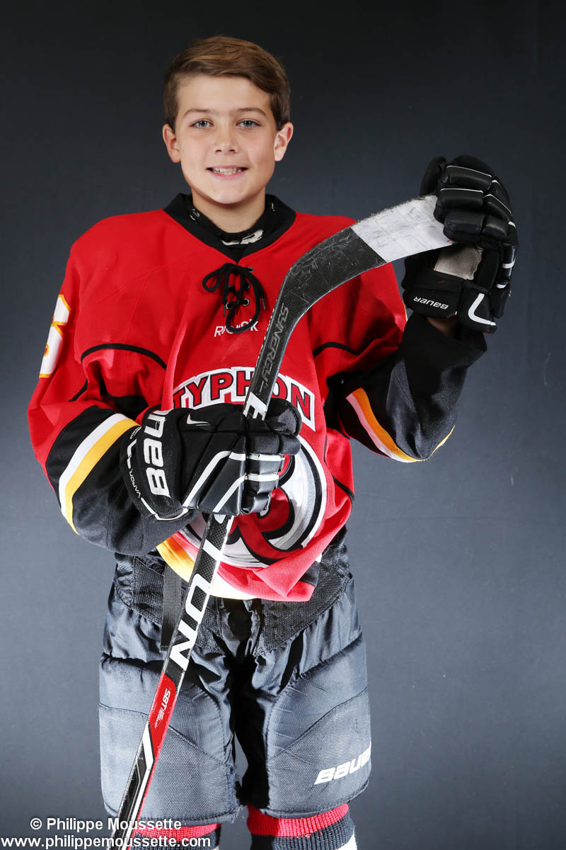 Hockeyeur avec son équipement et son bâton