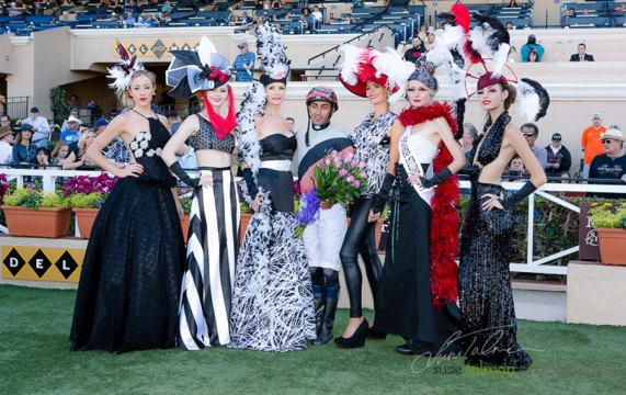 Studio Savvy Models strike a pose with the winning jockey in the Winners Circle at the 2015 Bing Crosby Opening Day at Del Mar