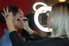 Studio Savvy Salon Nikki Caswell doing hair and makeup at San Diego Marriott Marquise Wedding Party Expo