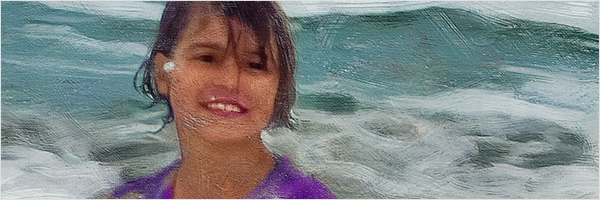 tight crop of girl playing in water portrait showing texture and detail