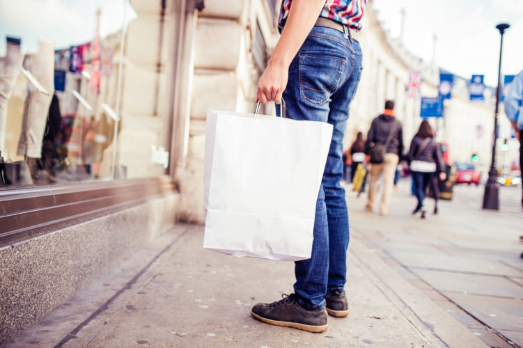young-man-shopping-in-the-city-PK53KTF