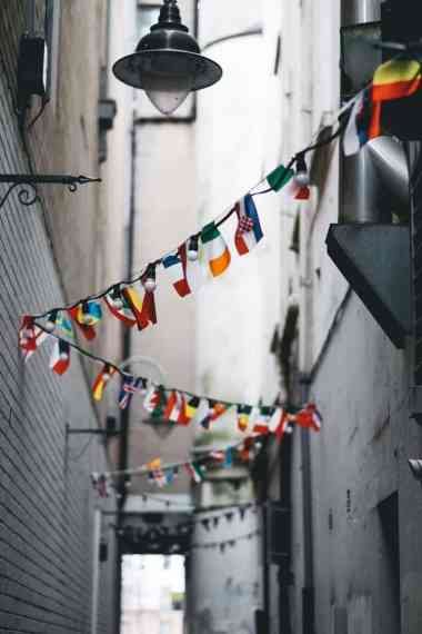 multi-country bunting flags on pathway