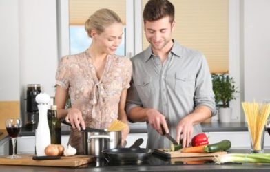couple cooking home-cooked meal