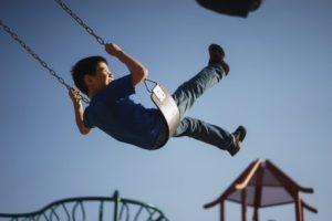 Child playing on swing set