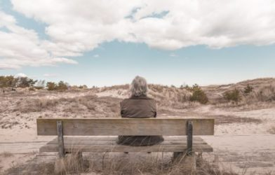 Elderly person sitting alone