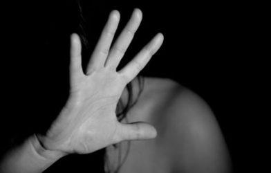 Scared woman shielding herself