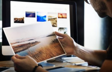 Man looking at photographs