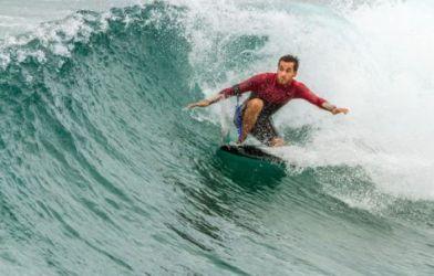 Surfing man on surfboard