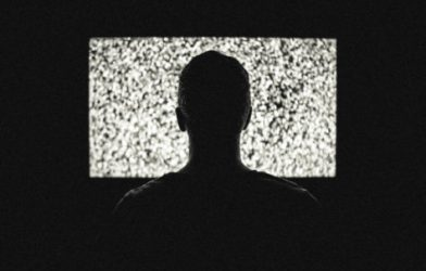 Person in front of static television