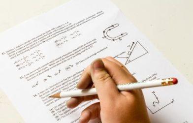 Student doing homework, taking exam