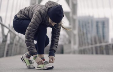 Woman tying shoes before running