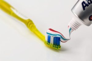 Toothbrush with toothpaste for brushing teeth