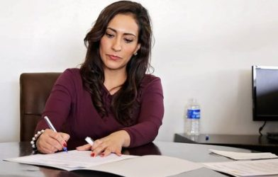 Woman in office doing paperwork