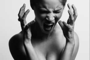 Stressed woman screaming