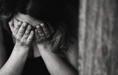Sad woman with face in hands
