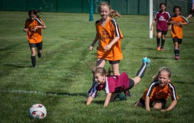 Young girls playing soccer