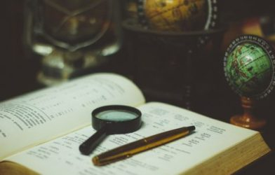 Science - magnifying glass on book