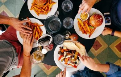 People eating burgers at restaurant