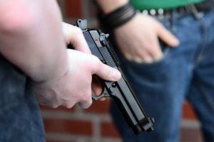 Person holding a gun