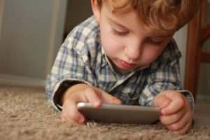 Child playing with smartphone