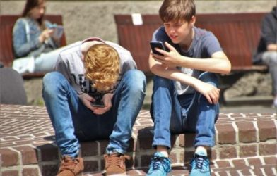 Teens using smartphones