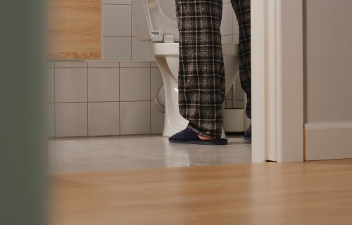 Man going to the bathroom at night