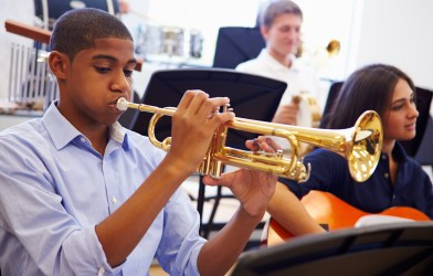 Teen Playing Trumpet In High School Band