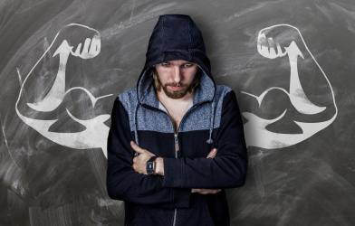 Man standing in front of muscles