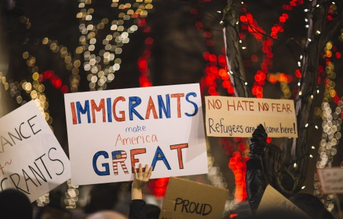 """Immigrants make America Great"" sign held during immigration rally"
