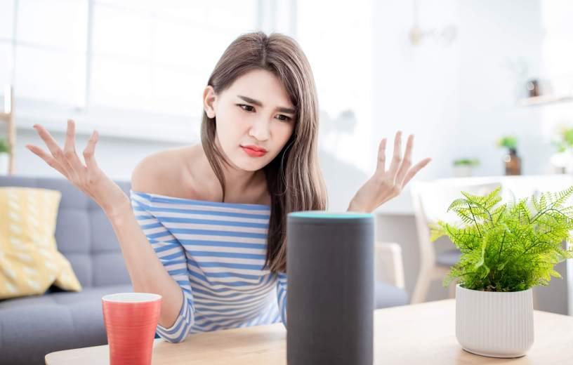 Woman using digital assistant Alexa