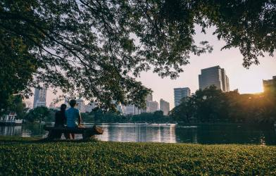 People sitting on a bench at a city park