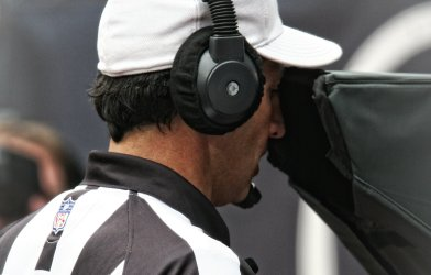 NFL Referee Looking at Instant Replay