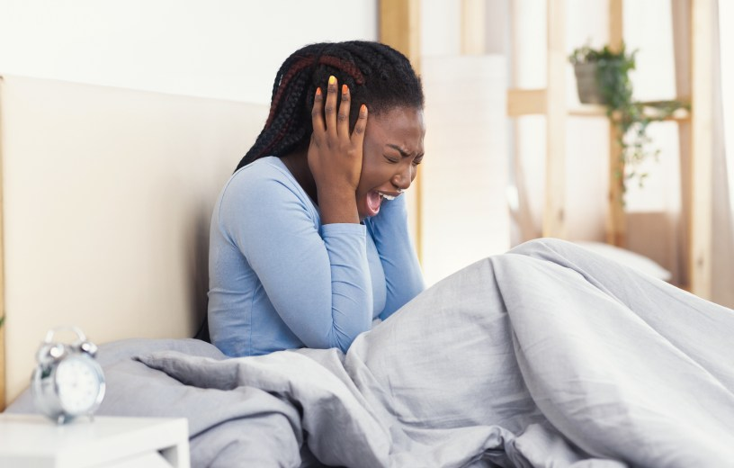 Woman screaming from bad dream or nightmare
