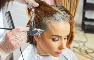 Woman having her hair dyed at beauty salon