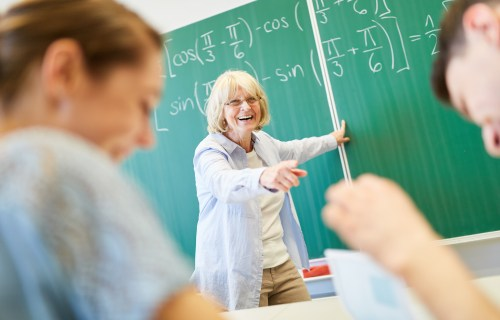 Teacher or professor laughing with students