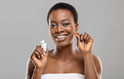 Oral health and hygiene: Woman flossing