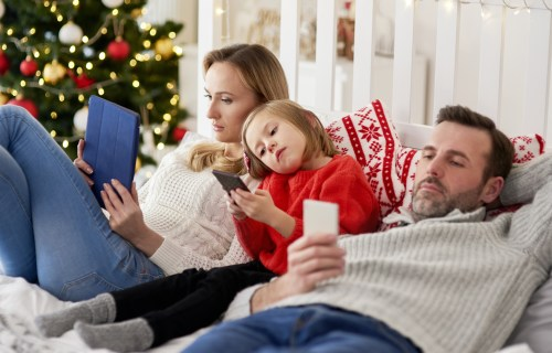 Family using their phones on Christmas