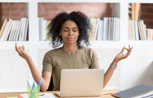 Woman practicing mindfulness meditation at work
