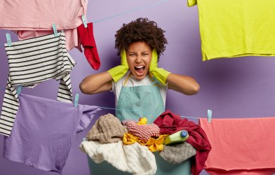 Woman stressed out from cleaning