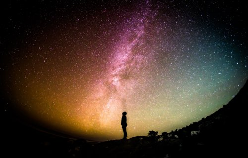 Person looking at stars, planets in night sky