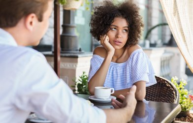Woman disinterested while on date, upset with partner