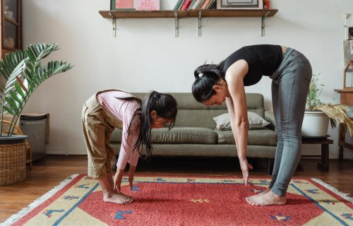 Mother and daughter stretching and exercising
