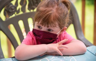 Little girl wearing face mask during coronavirus / COVID-19 outbreak