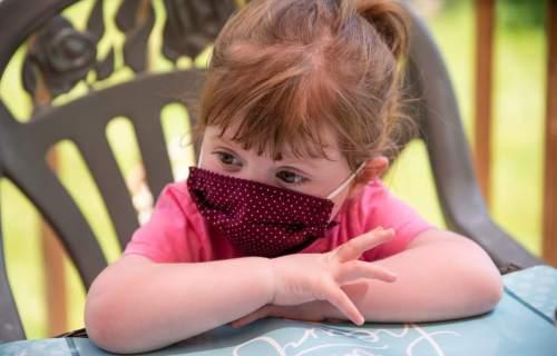 Little girl wearing face mask during coronavirus / COVID-19 outbreak