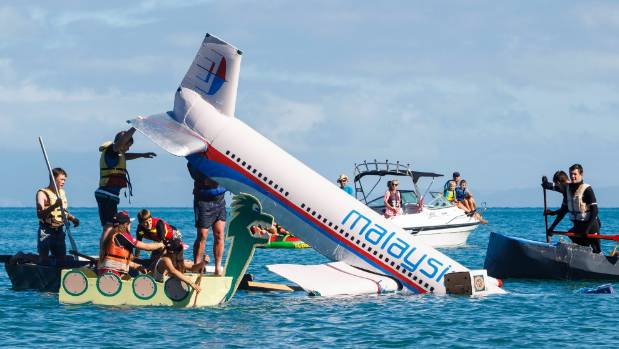 The Malaysian Airlines cardboard boat nose dives into the water at the Tata Beach Titanic Cup in Golden Bay.