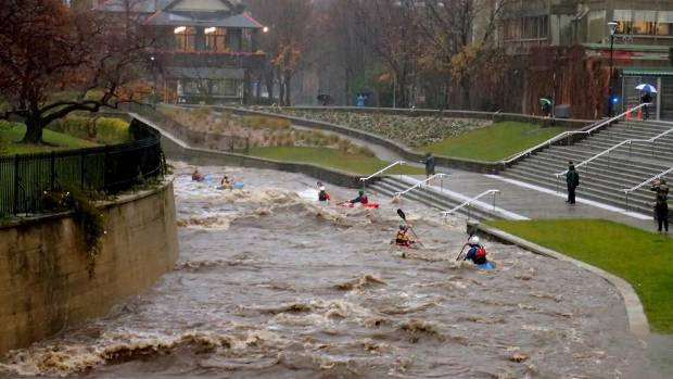Kayakers negotiate flood waters on Leith stream at Otago University during flooding in Dunedin on Wednesday.