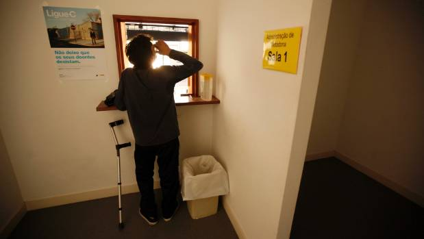 A patient drinks his doses of methadone at a rehabilitation clinic in Lisbon in this 2012 file photo.