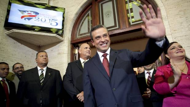 Puerto Rico's Governor Alejandro Garcia Padilla waves after delivering his state of the Commonwealth address at the Capitol building in San Jua in April.